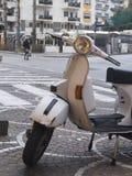 Vespa moto. White Vespa, in a street of the historic center of sorrento sa Italy royalty free stock image