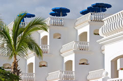 White villa with sunshades Royalty Free Stock Image