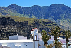 White village below high peaks, Canary Islands Royalty Free Stock Photography