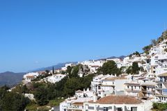 White village in Spain Mijas Pueblo. The white village of Mijas Pueblo in Spain with the Sierra Mijas mountains in the background royalty free stock photos