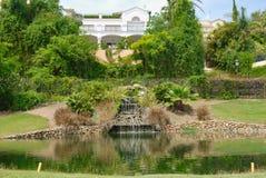 White Villas next to golf pond Stock Photos