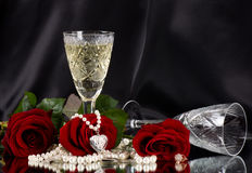White vine glass with red roses. On black background Royalty Free Stock Images