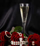 White vine glass with red roses. On black background Stock Photos