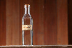 White vinegar. On wooden background royalty free stock image