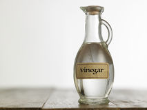 White vinegar. On the wooden table top stock photo
