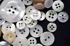 White vintage buttons. A heap of white mother-of-pearl vintage buttons. Macro shot Stock Photos