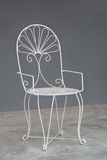 White vintage chair on gray wall. Old,Rusty, White vintage chair on gray wall Stock Image