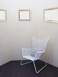 White vintage chair with pillow at room corner. Royalty Free Stock Photo