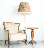 White Vintage classical farbirc style Chair with lamp Royalty Free Stock Image