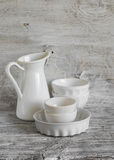 White vintage crockery - enamelled jug, ceramic bowl and baking dish Royalty Free Stock Photo