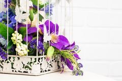 White vintage decorative bird cage with beautiful flowers Royalty Free Stock Photos