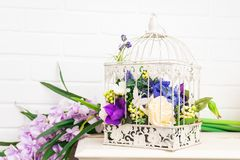 White vintage decorative bird cage with beautiful flowers Stock Images