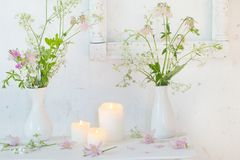 White vintage interior with flowers and candles. The white vintage interior with flowers and candles stock image