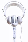 White vintage microphone and headphones Royalty Free Stock Photography