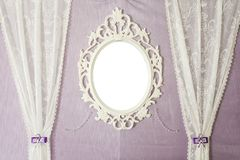 White vintage mirror on the wall. Close-up stock image