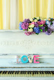 White vintage pianino with Love latters Stock Photos