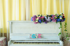 White vintage pianino with Love latters Stock Images