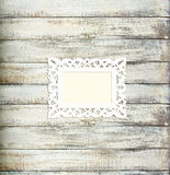 White Vintage picture frame on old wood background Royalty Free Stock Photos