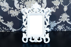 White Vintage picture frame on old wood background Stock Image