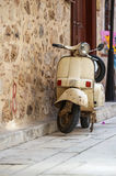 White vintage scooter parked Royalty Free Stock Photography