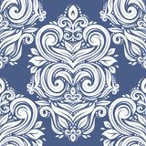 White vintage seamless pattern on a blue background. Royal, Victorian, Baroque elements. vector illustration