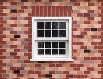 White vintage window on brick wall Royalty Free Stock Image