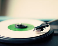 White vinyl record. In a turntable Royalty Free Stock Photo