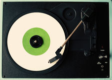 White vinyl record. In a turntable Stock Photos