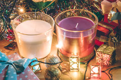 White and Violet Candle, ornament and christmas decorate for merry christmas night and happy new year. Santa claus hold bell and christmas candle, couple teddy Royalty Free Stock Photography