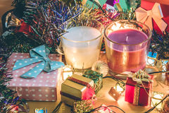 White and Violet Candle, ornament and christmas decorate for merry christmas night and happy new year. Santa claus hold bell and christmas candle, couple teddy Stock Images