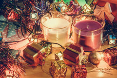 White and Violet Candle, ornament and christmas decorate for merry christmas night and happy new year. Santa claus hold bell and christmas candle, couple teddy Stock Photo