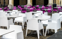 White and violet chairs and tables in  cafe Stock Photos