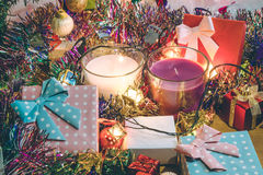 White and violet christmas candle, and  Ornament decorate Merry Christmas and happy new year. Santa claus hold bell and christmas candle, couple teddy bears and Royalty Free Stock Photo