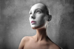 White visage. Portrait of a beautiful womanwith her visage colored in white Stock Photography