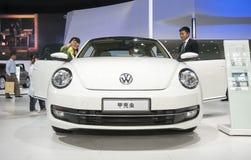 White volkswagen beetle car opened door Royalty Free Stock Image