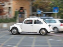 White Volkswagen Beetle vintage car blurred. MADRID, SPAIN - CIRCA OCTOBER 2017: white Volkswagen Beetle vintage car blurred Stock Photography