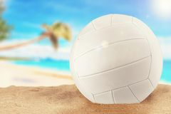 White volleyball ball at the beach on a sunny day. Stock Photo