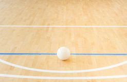 White volleyball on the floor in the gym.  stock images