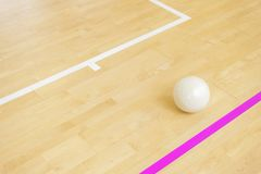 White volleyball on the floor in the gym.  royalty free stock photos