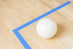 White volleyball on the floor in the gym.  royalty free stock images