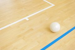 White volleyball on the ground in the school gym.  royalty free stock photos