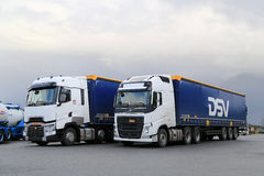 White Volvo FH and Renault Trucks T on a Yard Stock Photography