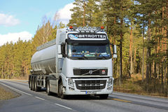 White Volvo FH Semi Tanker Trucking along Road stock images