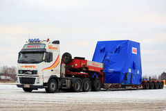 White Volvo FH16 Semi Trailer Hauls Wide Load in Winter Royalty Free Stock Photo