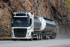 White Volvo FH Tank Truck on Highway with Rock Background Stock Image