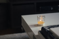 White Votive Candle on Top of White Wooden Table Royalty Free Stock Photos