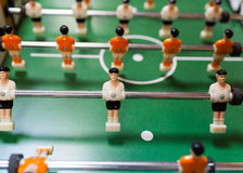 White vs orange in table football. A withe and orange football player from table game royalty free stock photo