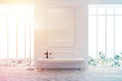 White waiting room poster and bench toned. White waiting room interior with a wooden floor, two large windows with a poster between them, and a white bench. 3d Stock Photo