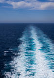 White wake trails behind a fast ship Royalty Free Stock Photos