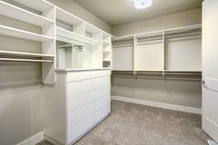 White walk-in closet with shelves, drawers and clothes rails. Northwest, USA royalty free stock photos